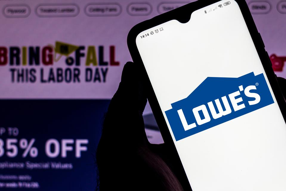 In this photo illustration the Lowe's Companies seen...
