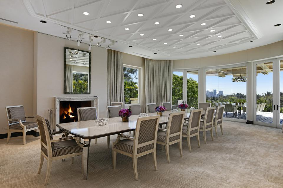 An indoor-outdoor dining room that opens up onto a terrace and overlooks downtown Los Angeles.