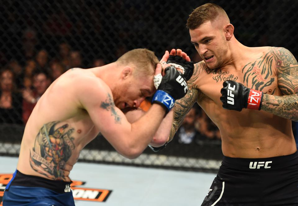 Dustin Poirier faces Conor McGregor in the main event of Saturday's UFC 257 pay-per-view fight card