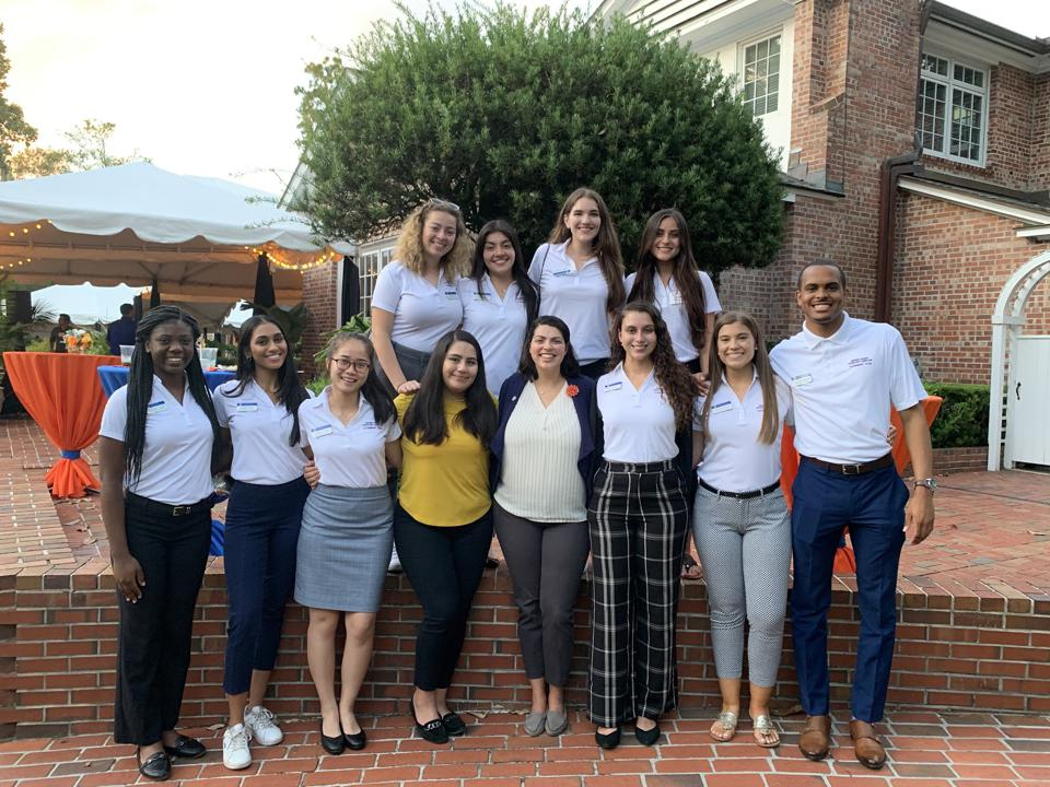 Author Erica Aguiar with students during a dinner reception in 2019