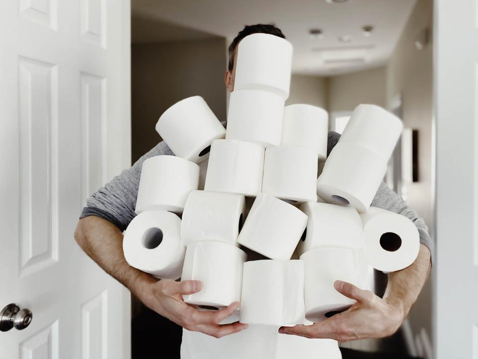 Man Carries Heap of Toilet Paper