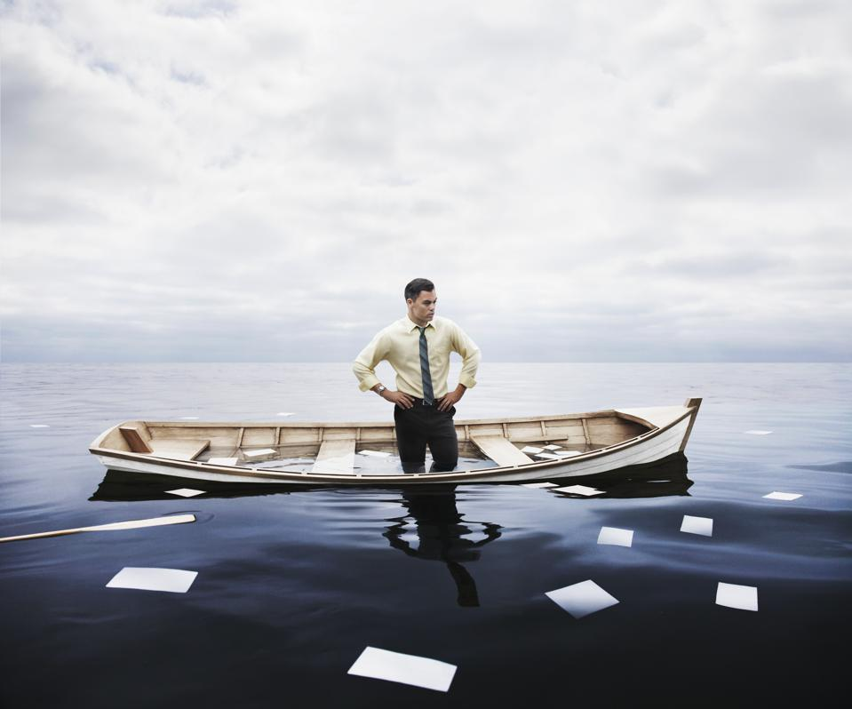 businessman in a sinking boat