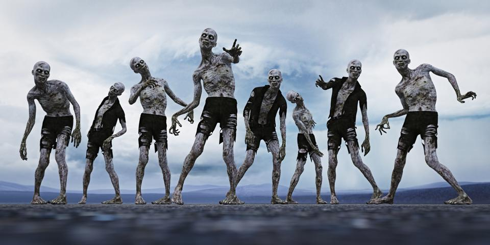 Group of zombies with glowing eyes walking and reaching out