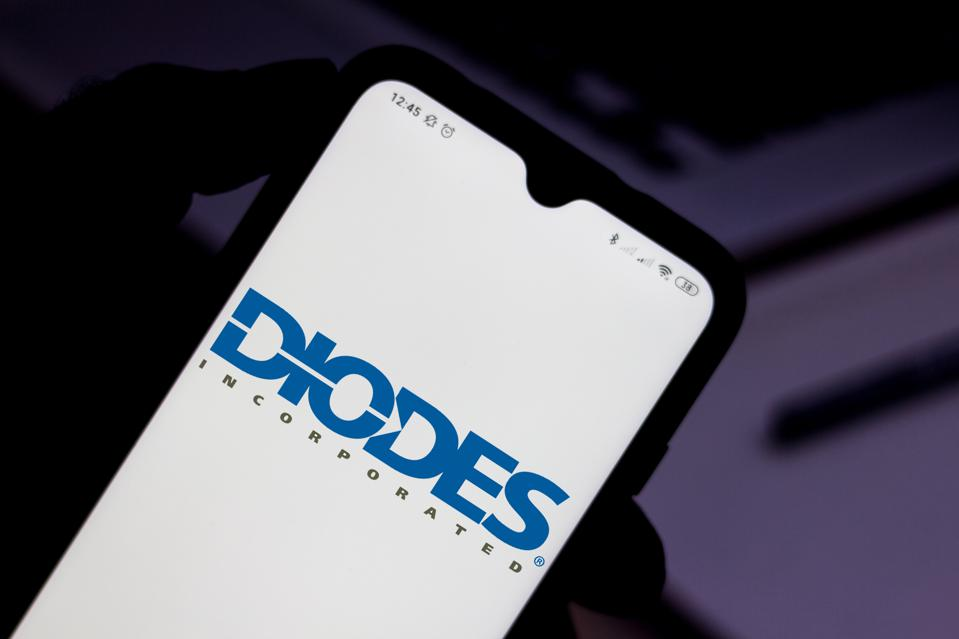 In this photo illustration the Diodes Incorporated logo seen...