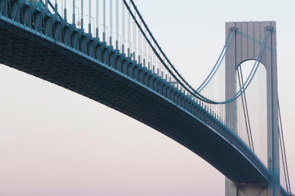 Verrazano-narrows bridge at sunrise, New York City, USA showing importance of leading through change.
