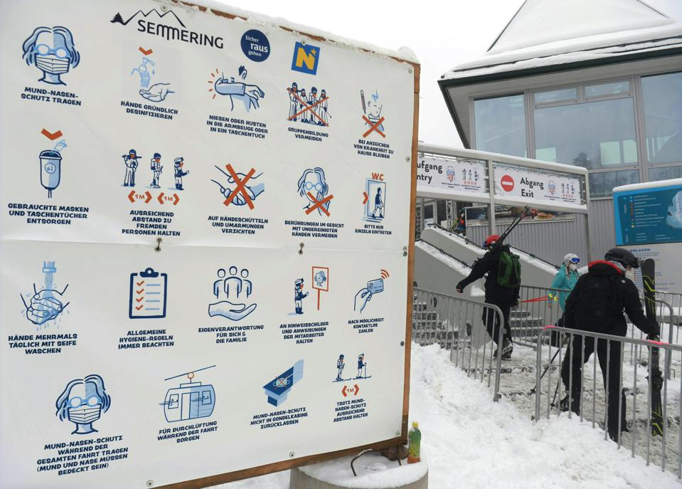 Skiers and rules of conduct during the Covid-19 pandemic taking the ski lift in Semmering, Austria, on January 6, 2021.