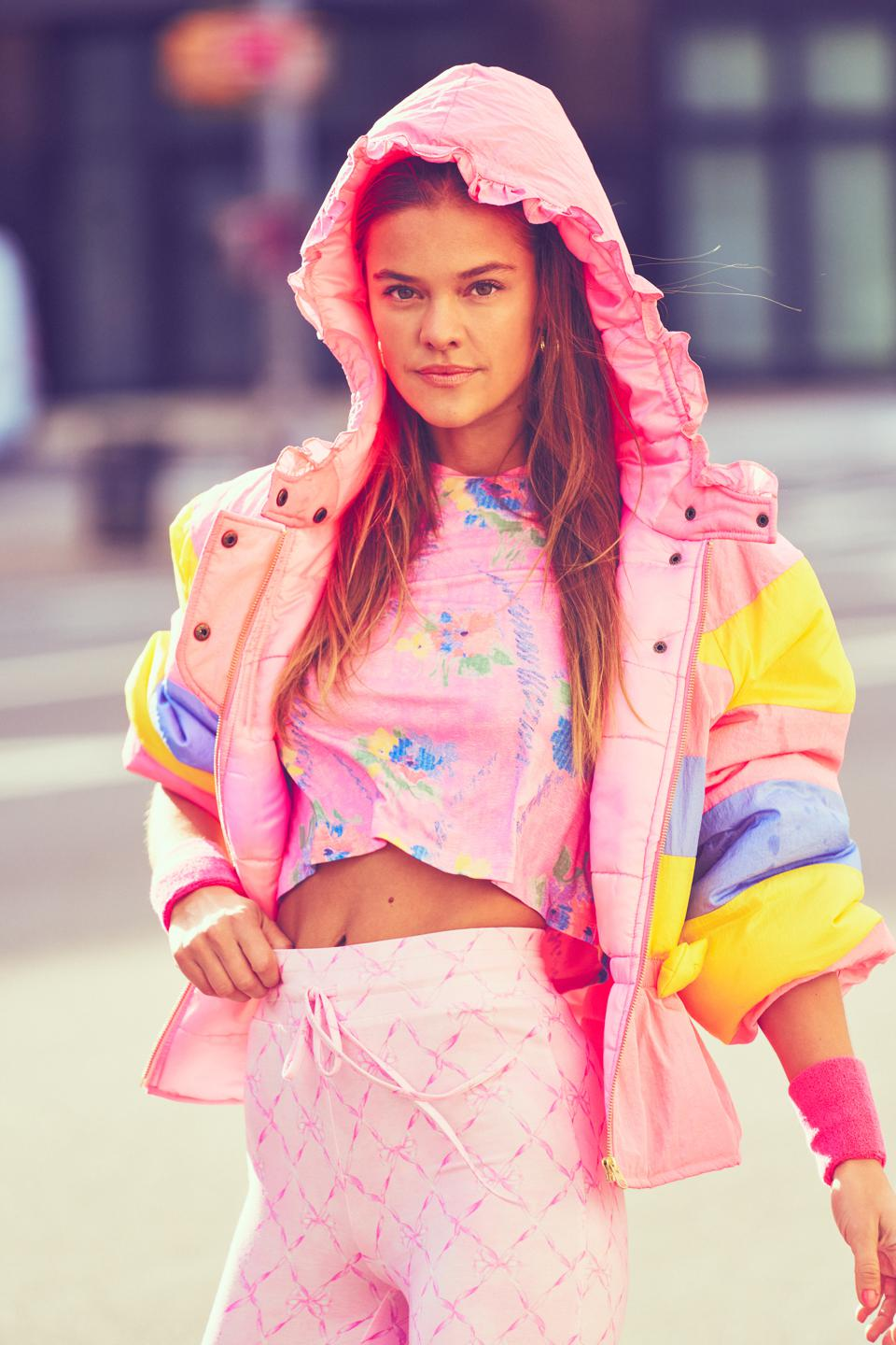 a model wears floral and pastel pieces of workout and athleisure clothes