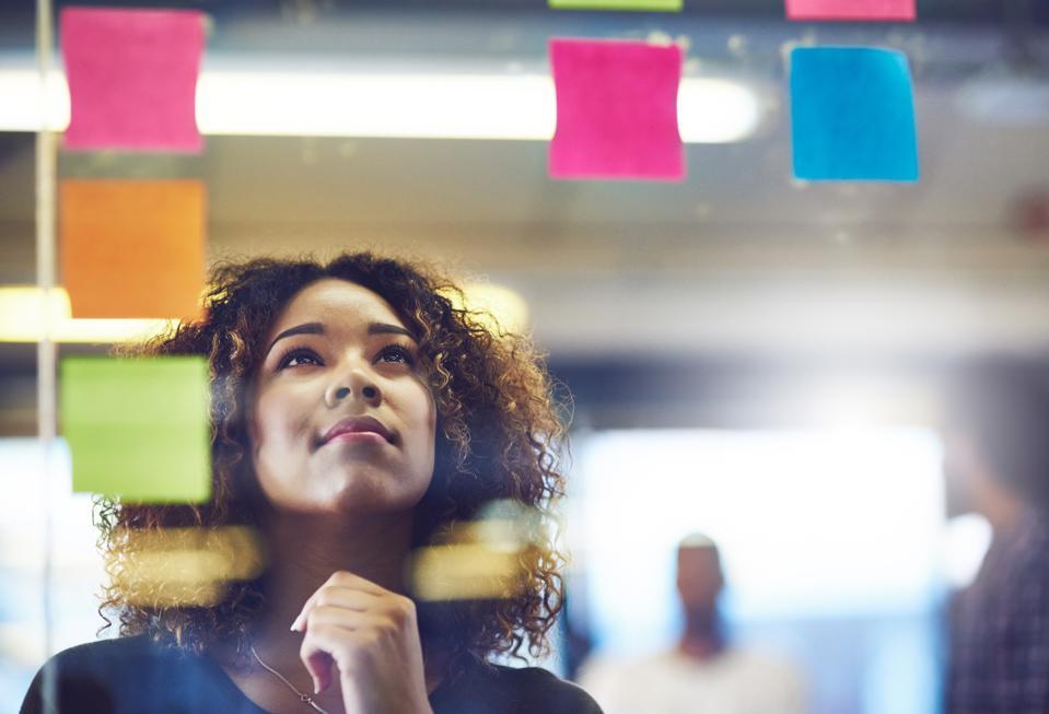 Woman brainstorming business idea