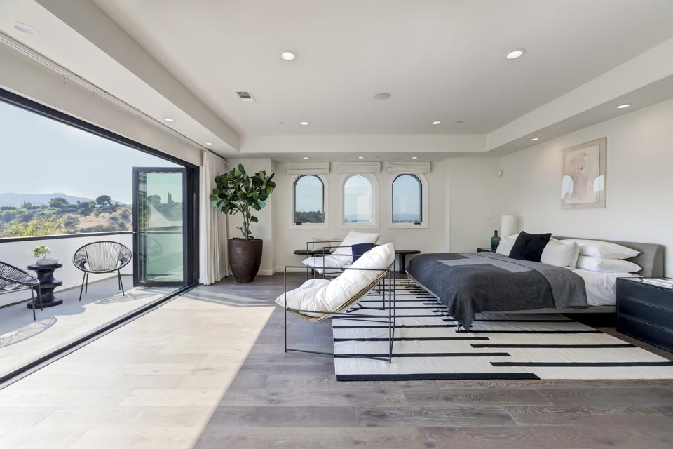 The primary bedroom in a luxury home.
