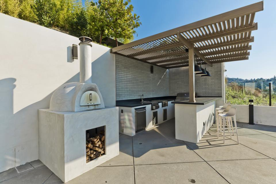 An outdoor kitchen and pizza oven.