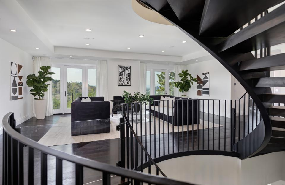 A living room and circular staircase.