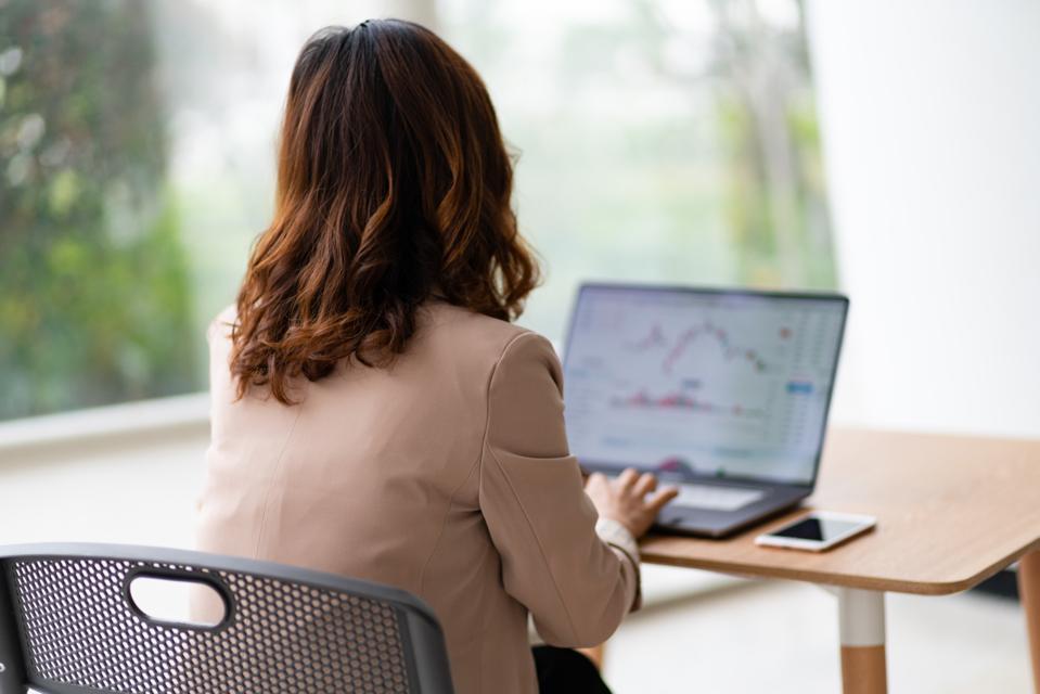 Watching stock market on laptop