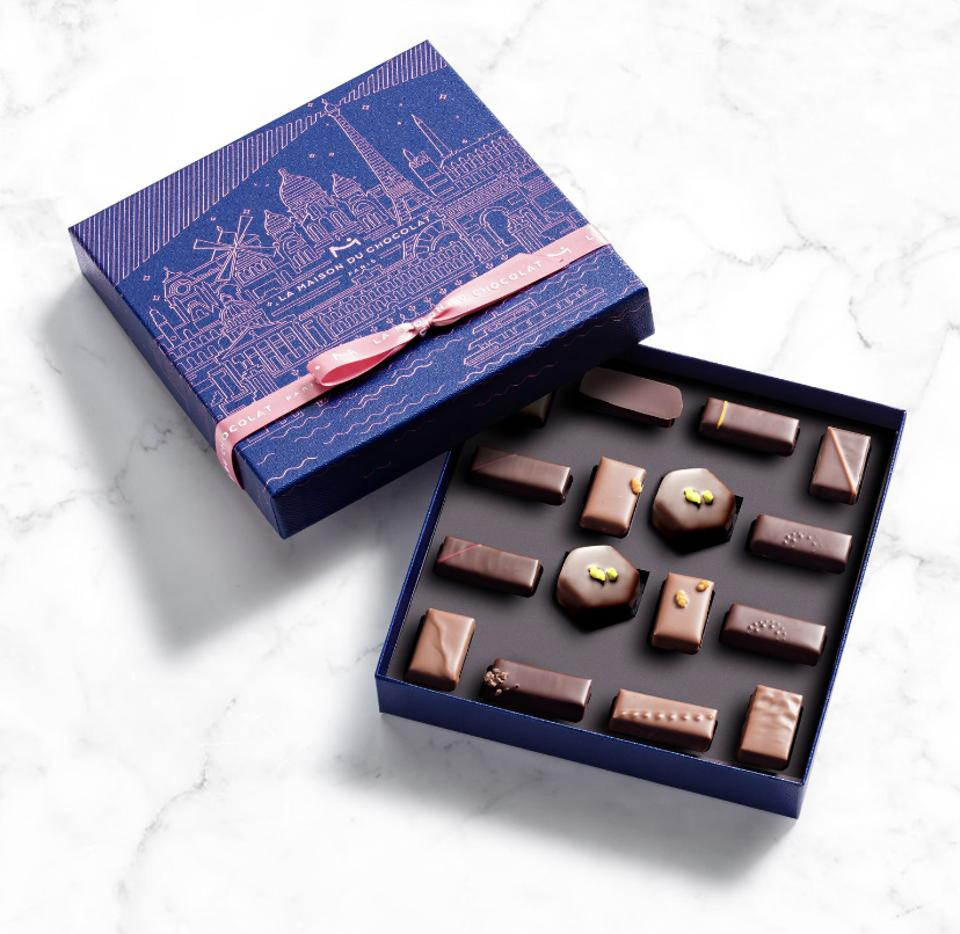 a blue box, maison du chocolat from paris, france with four types of hand made chocolates