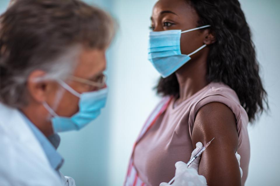 Young woman getting vaccinated