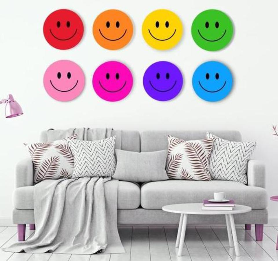 smiley faces on a wall with a sofa