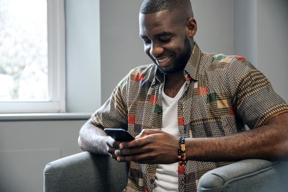 Young African Man Use Smart Phone