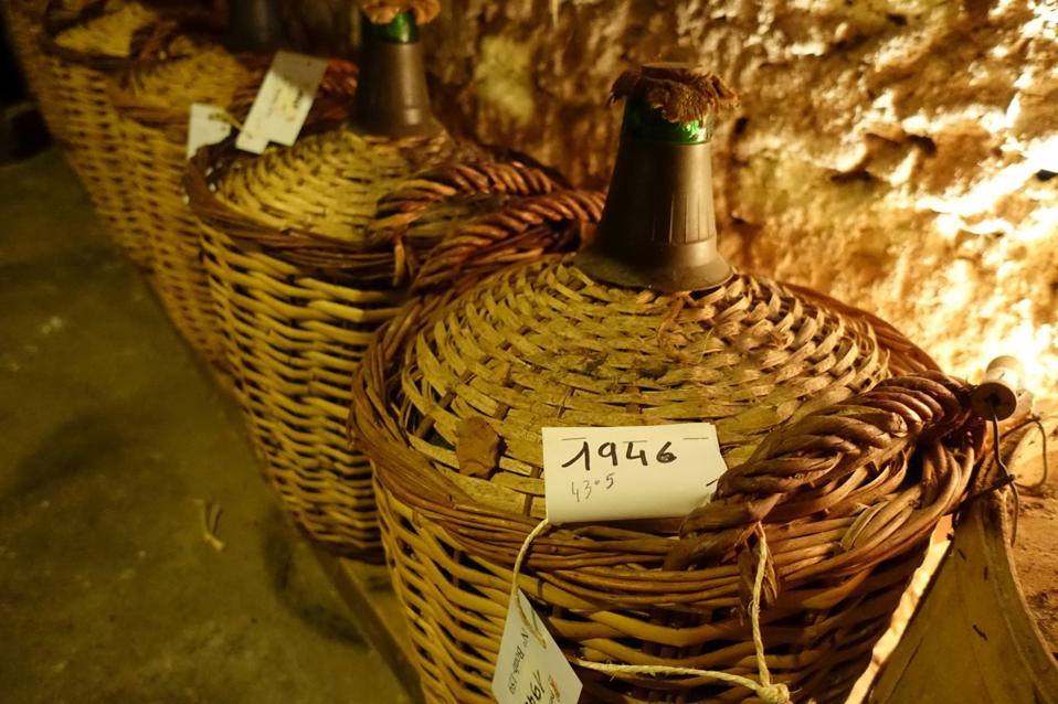 A glass demijohn of Armagnac