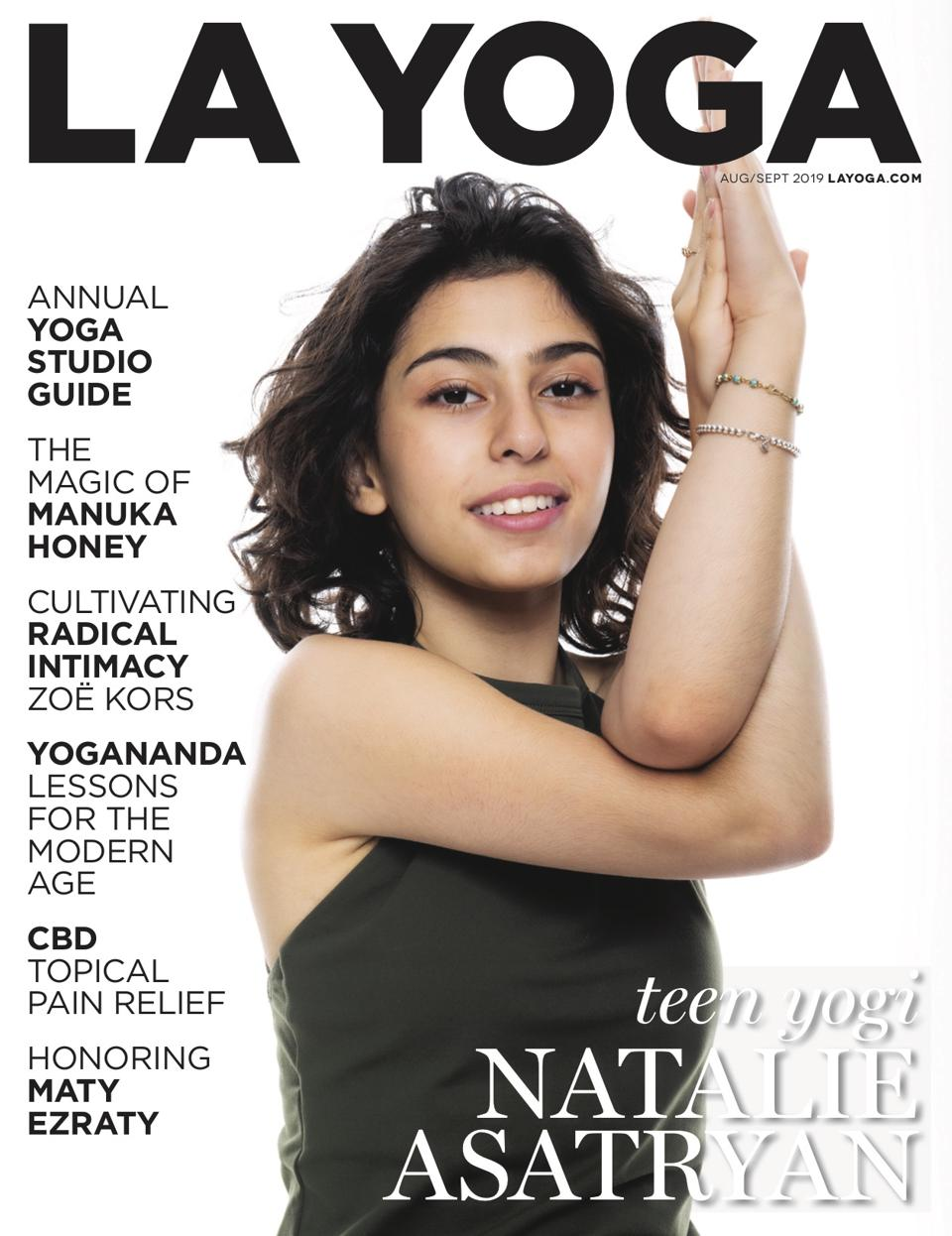 a teenage girl in a yoga pose on the cover of LA Yoga magazine