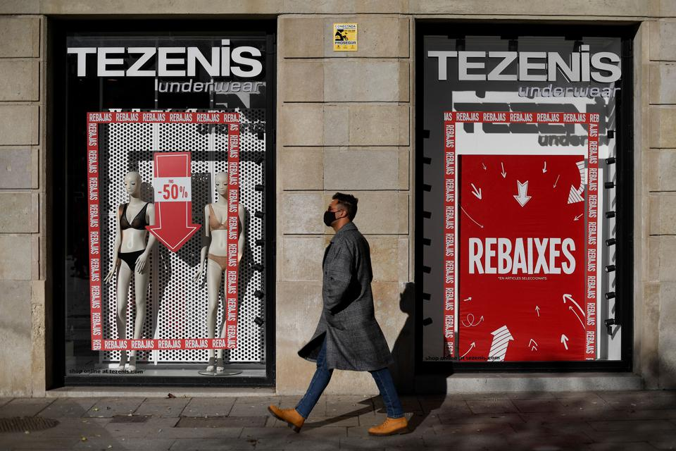 A man walks by a closed store on January 17, 2021 in Barcelona.