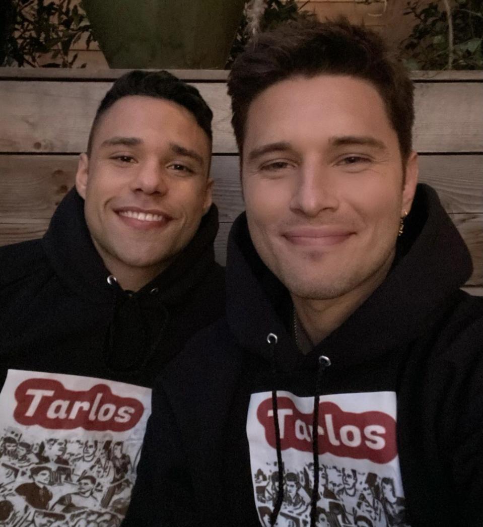 Ronen Rubenstein and Rafael Silva posing together in TARLOR hoodies.