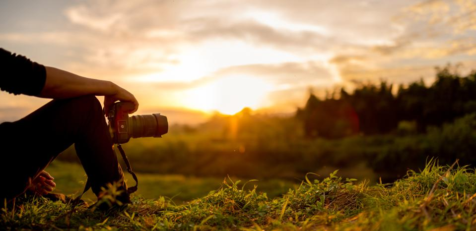 Photographer are sitting look the sunset