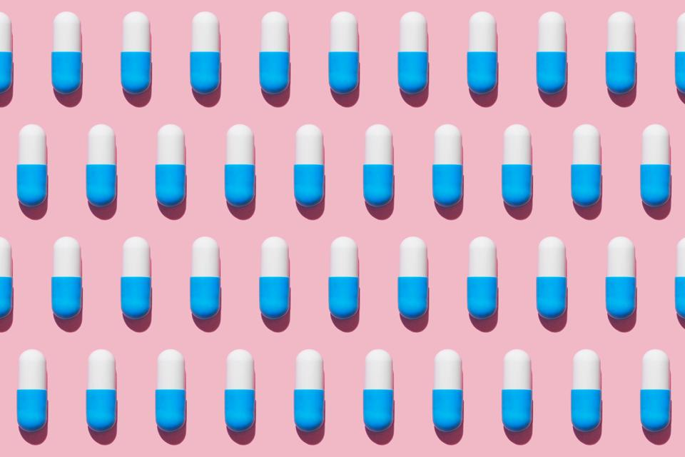 Repeated pills on pink background