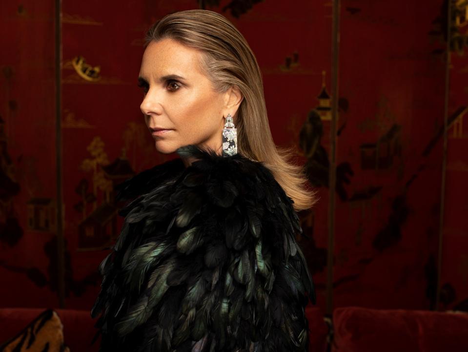 Silvia Furmanovich wearing earrings of abalone, lacquer, wood, diamond and tourmaline