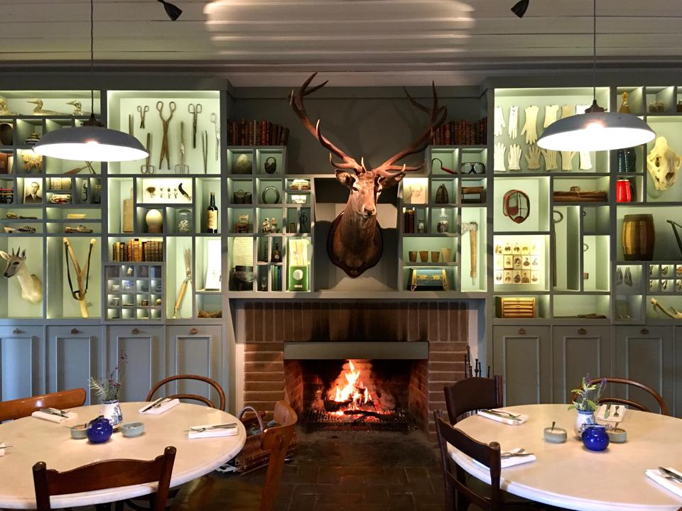 A fire burns in the dining room of São Lourenço do Barrocal hotel in the Alentejo Portugal
