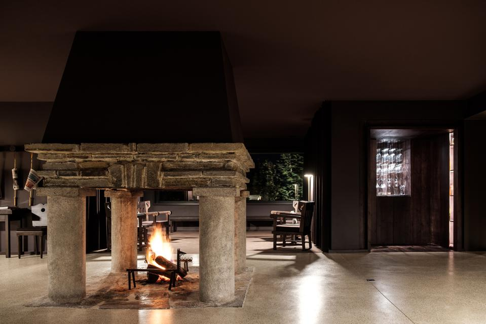 The fireplace at Casa de São Lourenço hotel in Portugal is historic, impressive and warm