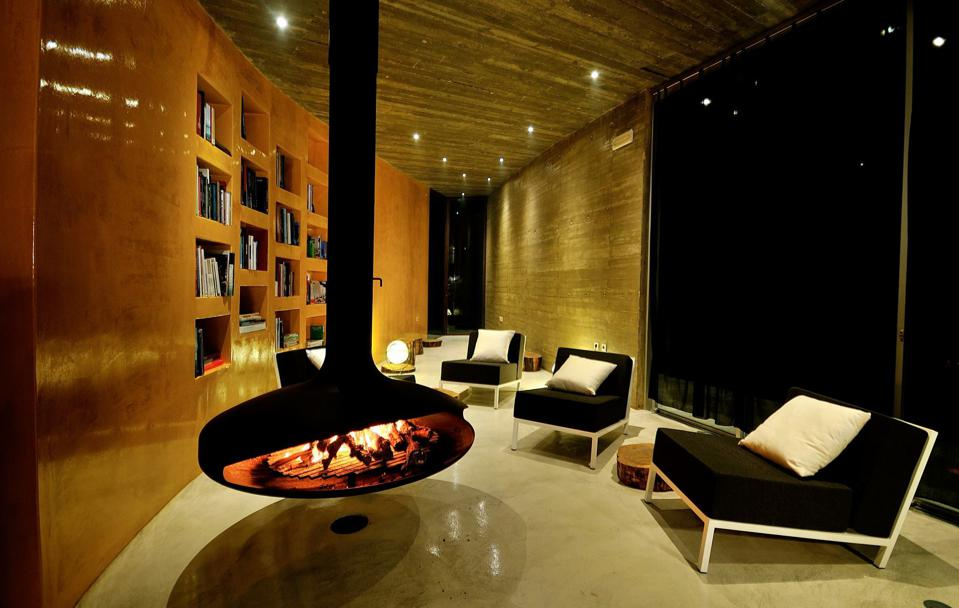 A hanging fireplace at Rio do Prado hotel in Óbidos, Portugal, welcomes guests
