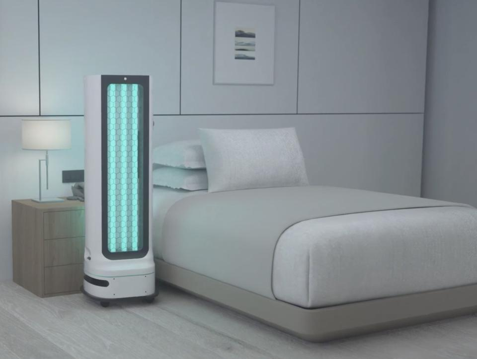 Robot using blue UV-C light to clean hotel room