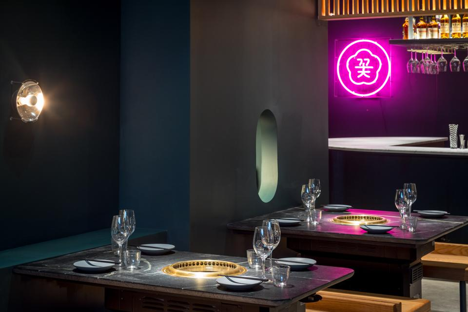 A sleek black interior at the new Cote Korean Steakhouse