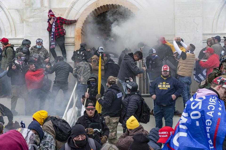 Police use tear gas around Capitol building where pro-Trump...