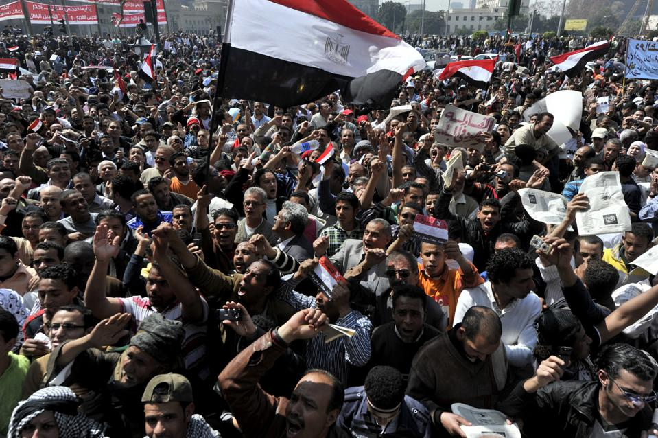 Egyptian chant slogans as they take part