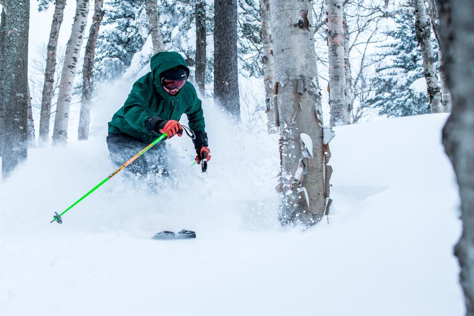 A skier going through the glades at Mount Snow.