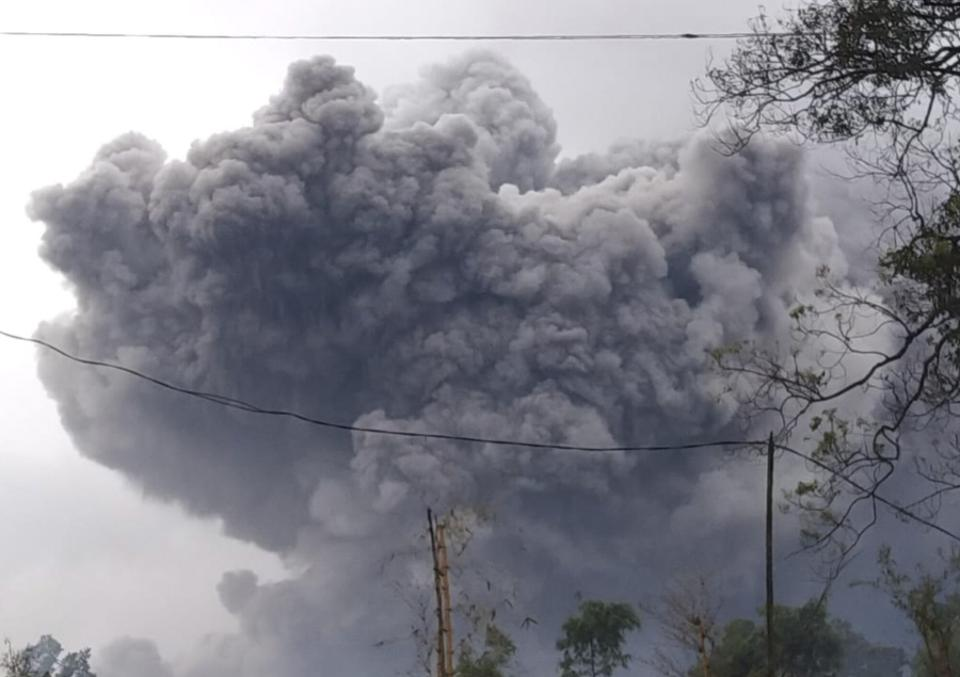 In this photo released by Indonesia's National Disaster Mitigation Agency (BNPB) Mount Semeru spews volcanic material during an eruption on Saturday, Jan. 16, 2021.