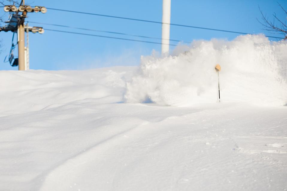 A skier coming down a powder run at Cranmore ski resort.