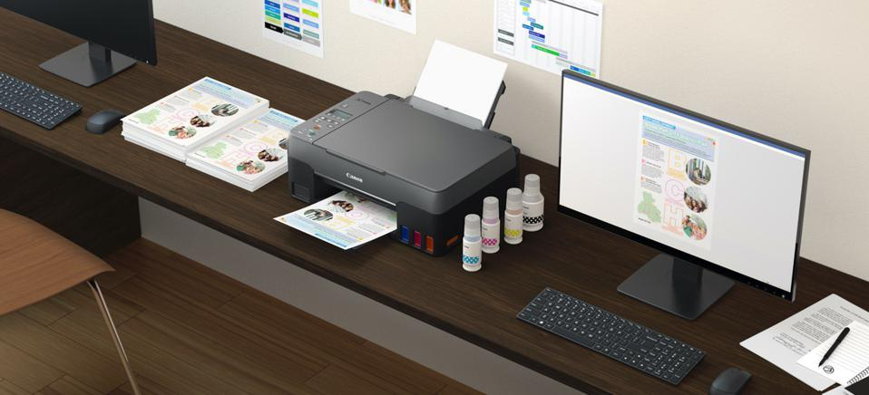 Desk with printer and spare ink bottles