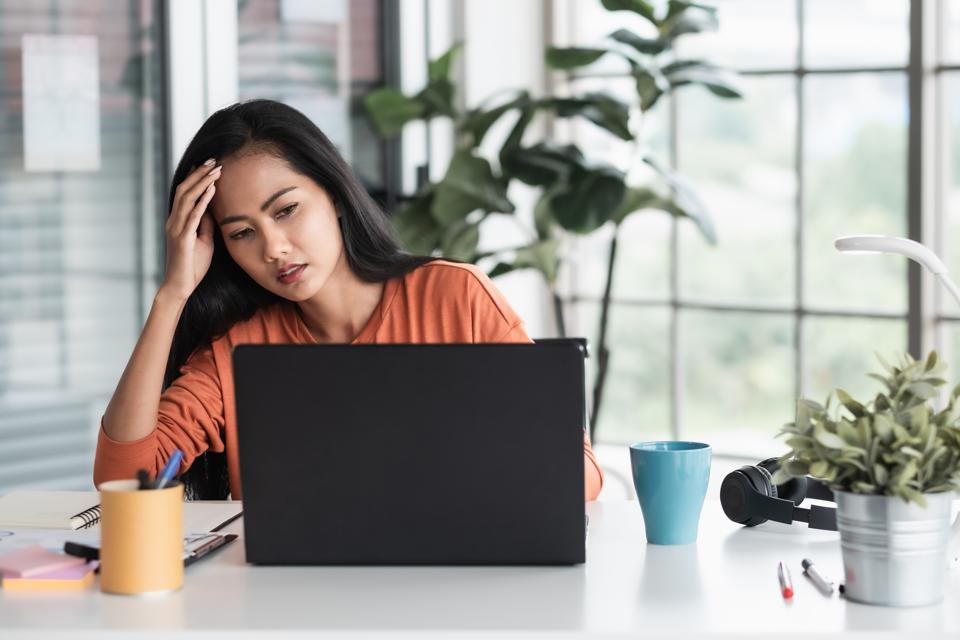 asian woman get stress about project in front of laptop while working from home.new normal with technology lifestyle