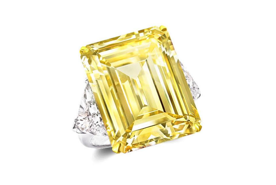 "Sun of Africa"" by Noor Jouel, a 12 carat fancy vivid yellow emerald cut ring. Available for $1,280.00."