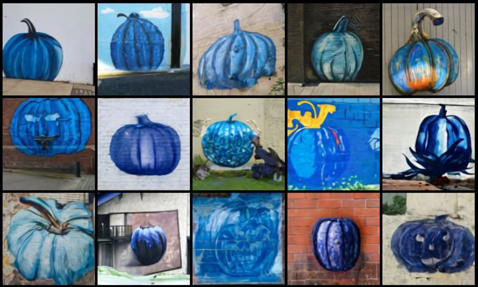 a mural of a blue pumpkin on the side of a building