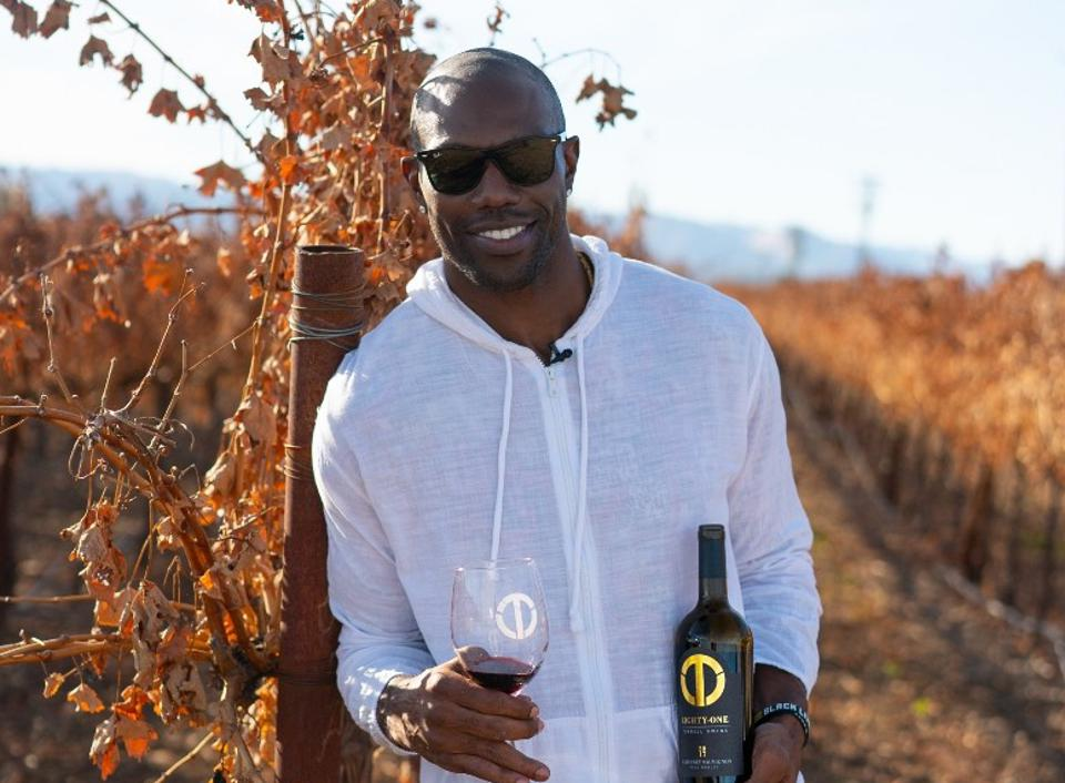 Terrell Owens poses with his new wine.