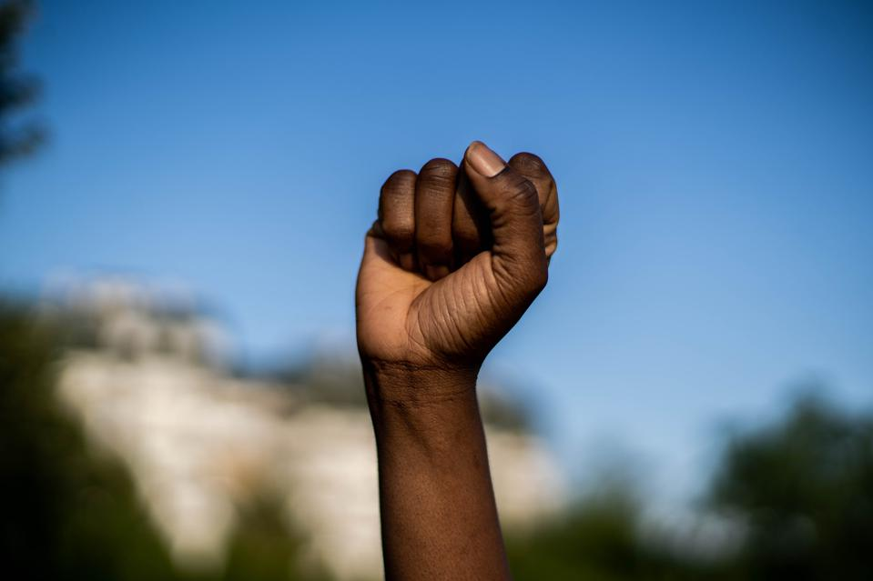 Raised fist in solidarity with Black Lives Matter.