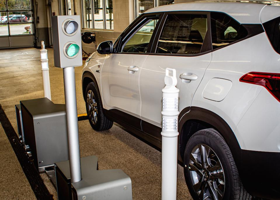 Flaws are detected automatically as a vehicle drives through the inspection station.