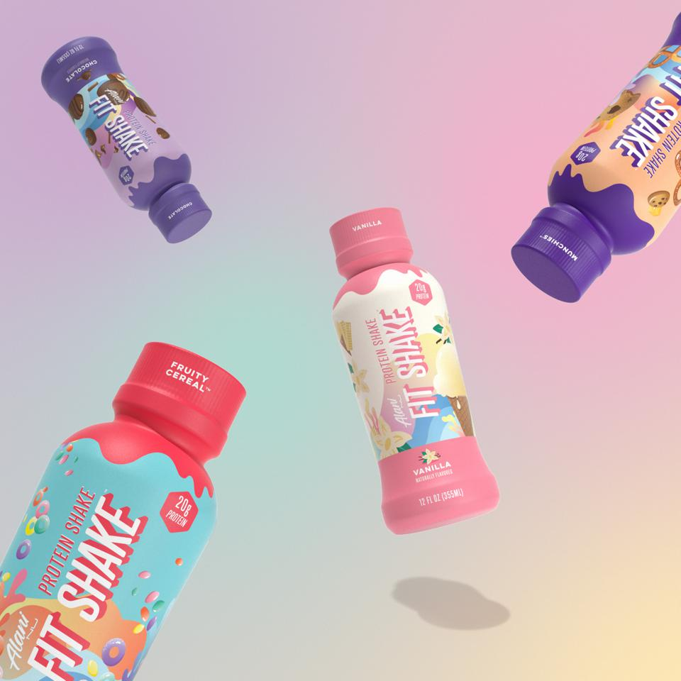 Four bottles of Alani Nu Fit Shake floating against a pastel colored background.