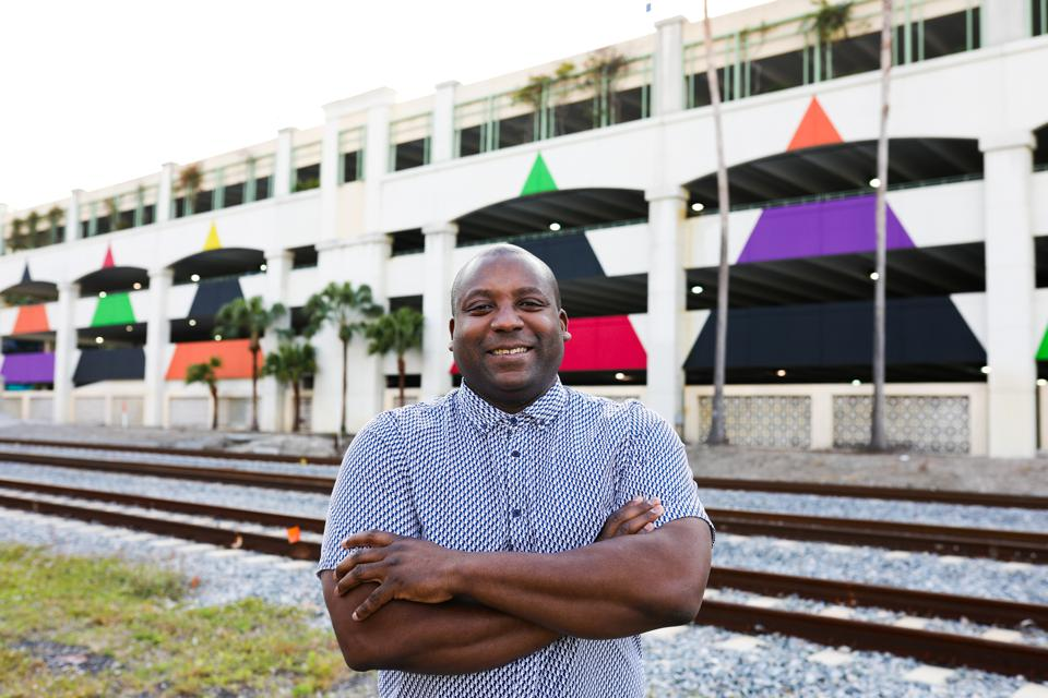 Artist Rico Gatson stands by his murals in West Palm Beach.