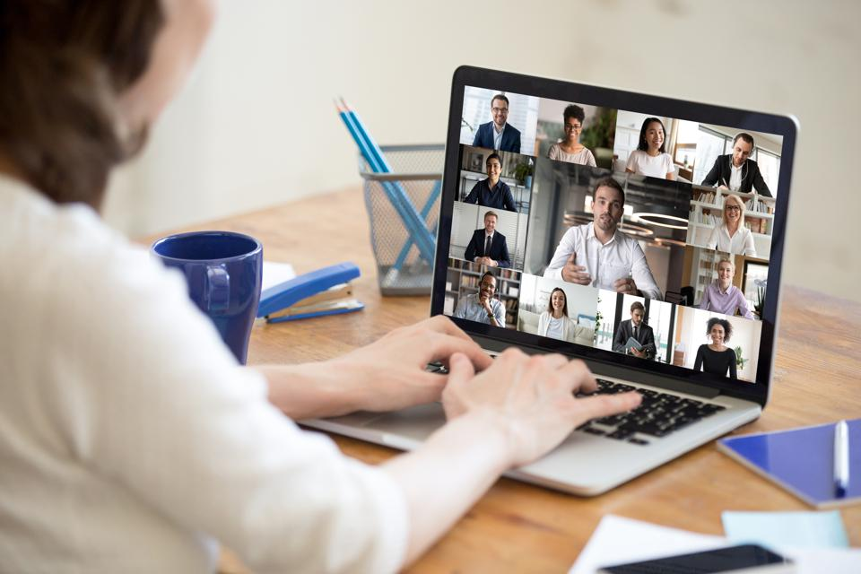 Laptop screen view diverse businesspeople involved at group videocall