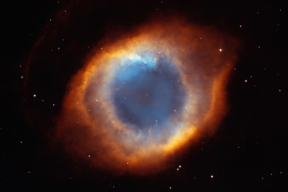 This photograph of the coil-shaped Helix Nebula is one of the largest and most detailed celestial images ever made. At 650 light-years away, the Helix Nebula is one of the nearest planetary nebulae to Earth. Credit: NASA, NOAO, ESA, the Hubble Helix Nebula Team, M. Meixner (STScI), and T.A. Rector (NRAO)