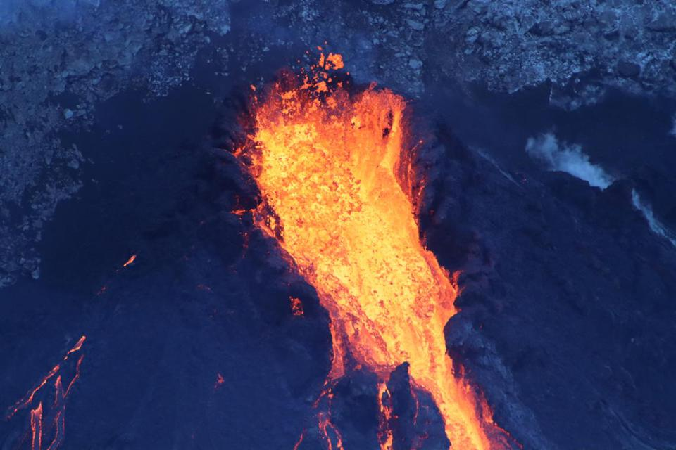 Lava rushes out of the pit crater's western fissure.