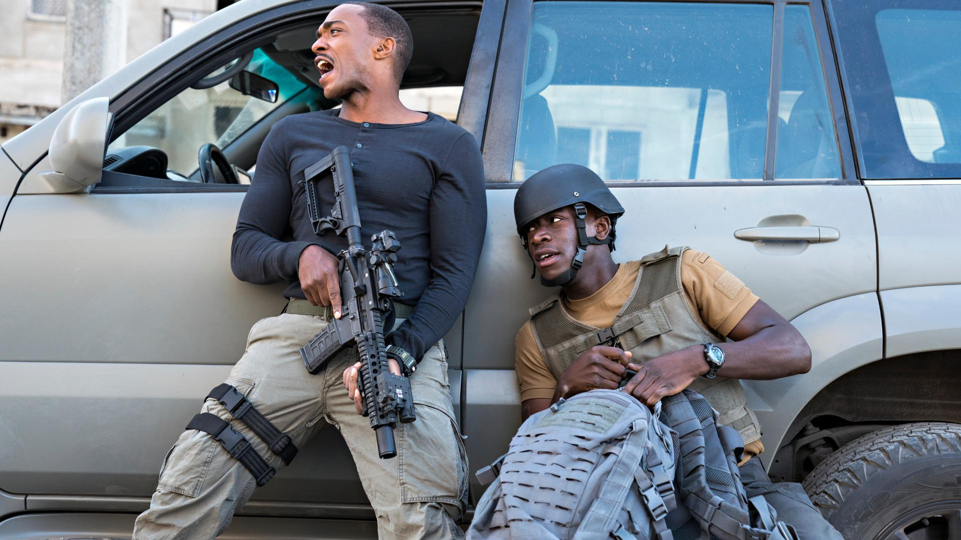 Anthony Mackie, as Leo and Damson Idris as Harp in OUTSIDE THE WIRE